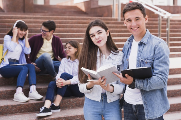 students-standing-with-open-books-looking-camera_23-2148166405